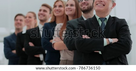 Close-up of employees of a business team standing with crossed a