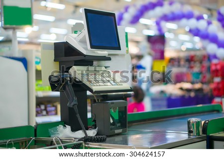 Close up of empty cash desk with computer terminal in supermarket
