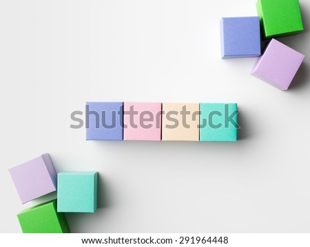 close-up of empty colorful paper cubes on white background. copy space available - stock photo