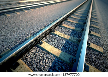Close up of empty straight railroad track. Perspective view. - stock photo
