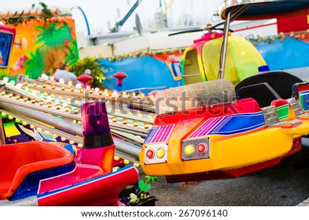 Close up of empty wet carousel on rainy day. Selective focus - stock photo