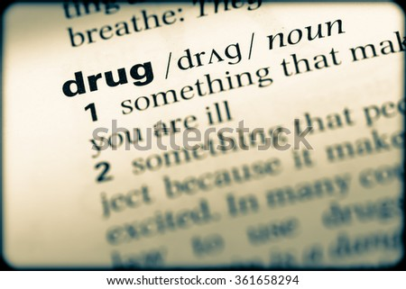 Close up of English dictionary page with word drug - stock photo