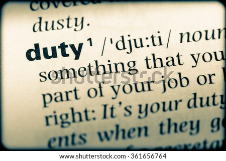 Close up of English dictionary page with word duty - stock photo