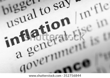 Close up of English dictionary page with word inflation - stock photo