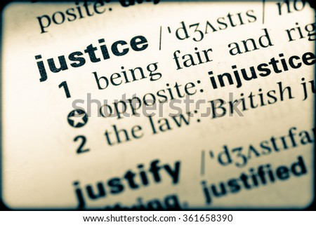 Close up of English dictionary page with word justice - stock photo