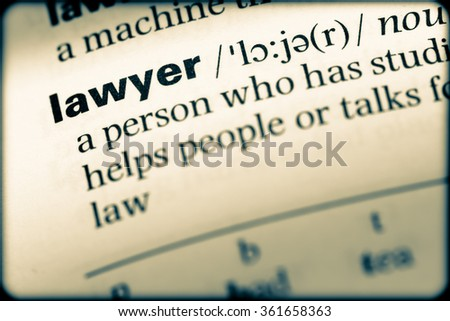 Close up of English dictionary page with word lawyer