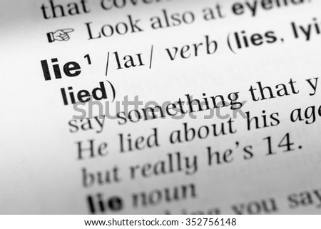 Close up of English dictionary page with word lie - stock photo
