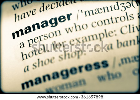 Close up of English dictionary page with word manager - stock photo