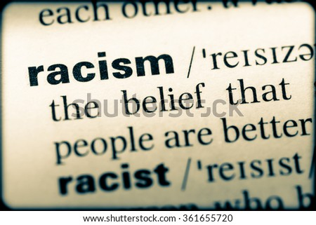 Close up of English dictionary page with word racism - stock photo