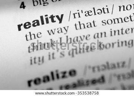 Close up of English dictionary page with word reality - stock photo