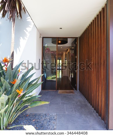 Close up of entry paving and front door of contemporary luxury Australian home - stock photo