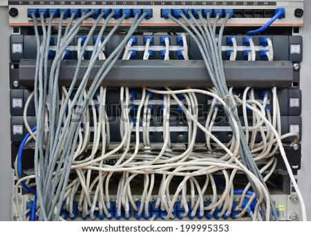 close-up of  ethernet cables connected to computer  internet server with many dust; lack of maintenance
