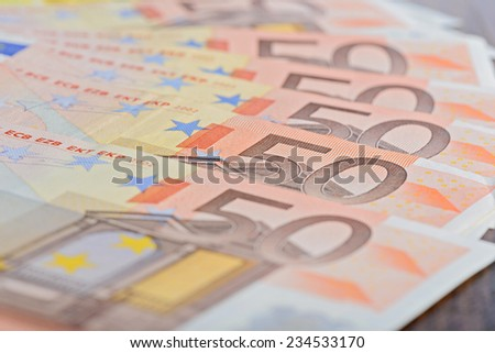Close-up of 50 Euro banknotes on the table - stock photo