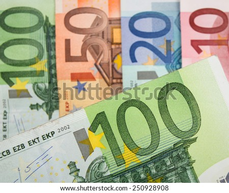 Close up of Euro banknotes with 100 Euros in focus - stock photo