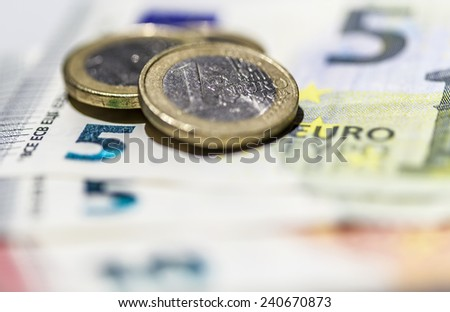 Close-up of euro billets and coins