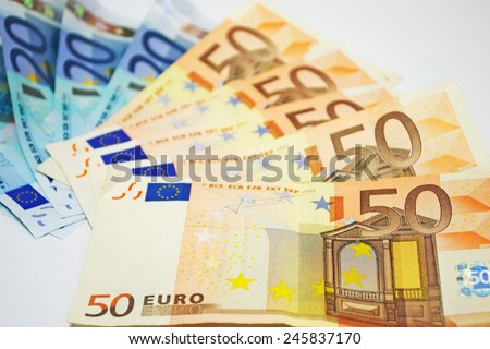 close up of euro bills on white background - stock photo