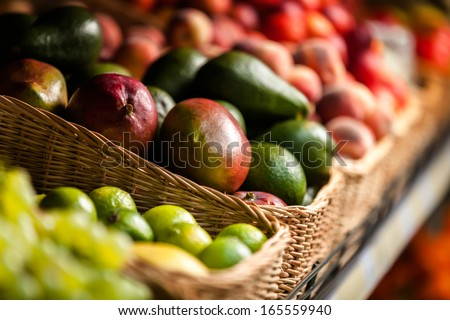 Close up of exotic fruits in the shop. Concept of healthy food - stock photo