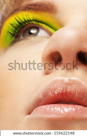 Close up of eyes, nose and lips with make-up beautiful young woman. - stock photo
