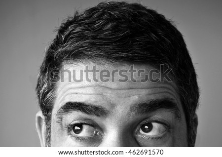 Close up of eyes of a man (age 40-45) looking for something. Man middle age concept. copy space