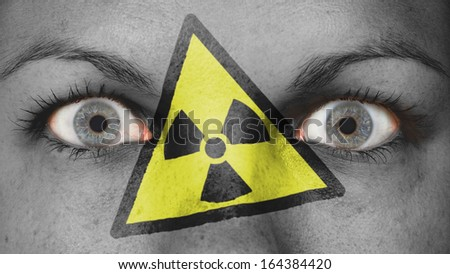 Close up of eyes. Painted face, danger, radioactive - stock photo