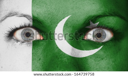 Close up of eyes. Painted face with flag of Pakistan - stock photo