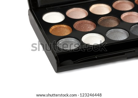 Close-up of eyeshadow palette with brush. Isolated on white background - stock photo
