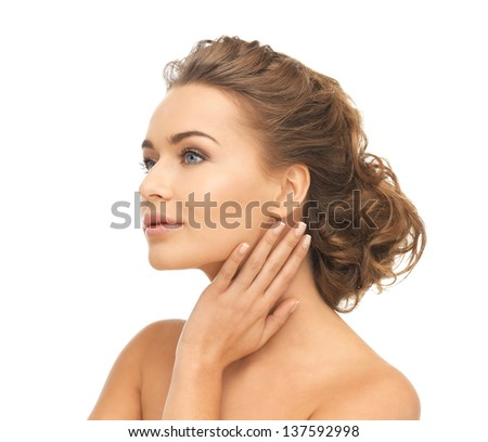 close up of face and hands of beautiful woman - stock photo