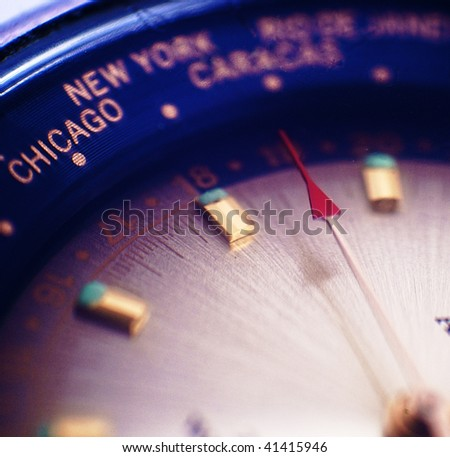 close-up of face of wrist watch toned blue - stock photo