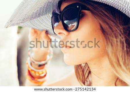 Close-up of face of young summer sexy woman wearing hat  and sunglasses. Outdoors lifestyle portrait - stock photo