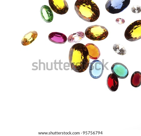 close up of falling gems isolated on white background - stock photo