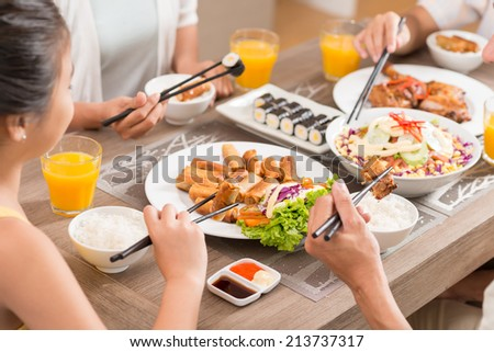 Close-up of family eating traditional Vietnamese food