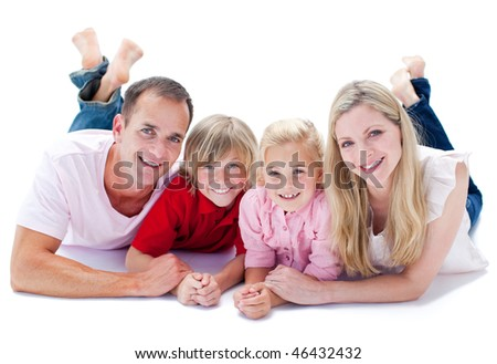 Close-up of family lying on the floor against a white background