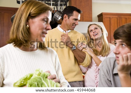Close-up of family with two teenage children in kitchen