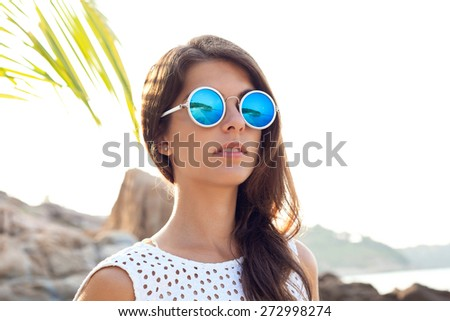 Close-up of Fashion sexy beautiful face of woman in sunglasses. Outdoors lifestyle portrait - stock photo