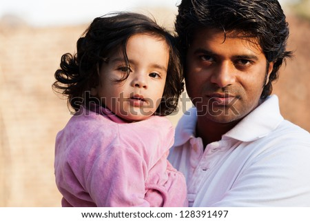 close up of father and daughter, Indian man with his one year old daughter