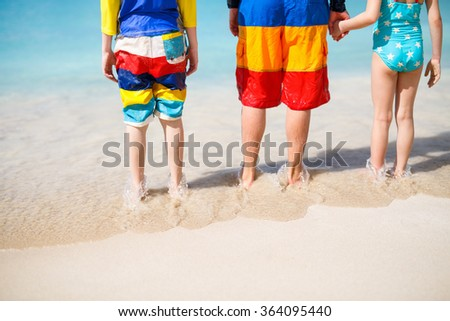 Close up of father and kids on a tropical sandy beach enjoying Caribbean vacation