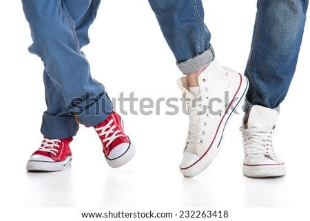 Close-up of father and little son feet in shoes. - stock photo