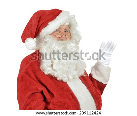 Close up of Father Christmas waving his hand isolated on a white background