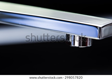 Close-up of faucet. - stock photo
