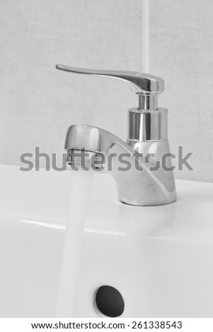 close up of faucet in bathroom