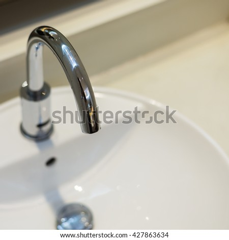 Close up of faucet in the bathroom - stock photo
