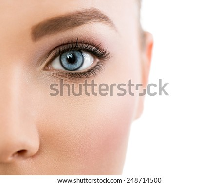 Close up of female beautiful blue eye - stock photo