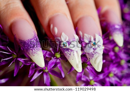 Close-up of female beautifully manicured nails in purple - stock photo