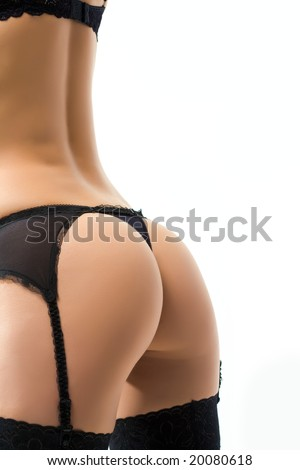 Close-up of female bottom with black panties and garter belt on - stock photo