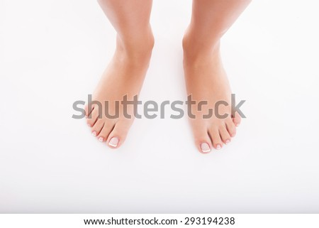 Close up of female cared legs. Isolated on background