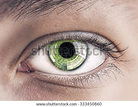 Close up of female clear green eye - stock photo