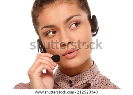 Close-up Of Female Customer Care Representative With Headset - stock photo