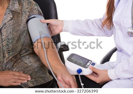 close-up of Female doctor measuring blood pressure of senior woman - stock photo