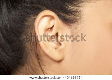 close up of female ear - stock photo