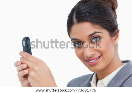 Close up of female entrepreneur with her mobile phone against a white background